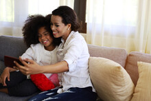 American Kid Girl Smile Portrait And Selfie Photo With Mother At Home.