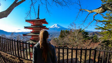Girl Admiring Chureito Pagoda And View On Mt Fuji, Japan, Captured On A Clear, Sunny Day In Winter. Top Of The Volcano Covered With Snow. Girl Is Enjoying Her Time, Contemplating The Beauty Of Nature