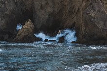 Waves Crashing Through Rocks In Big Sur, California