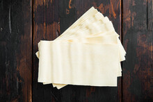 Dried Uncooked Lasagna Pasta Sheets, On Old Dark  Wooden Table Background, Top View, Flat Lay