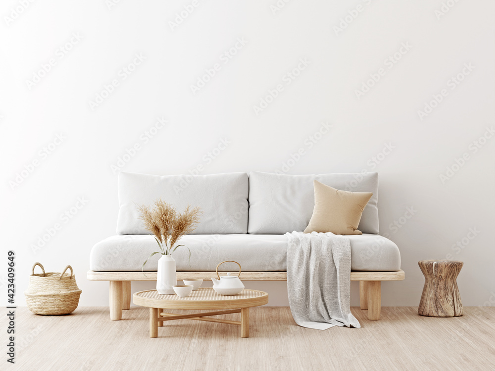 Fototapeta Living room interior wall mockup in warm neutrals with low sofa, dried Pampas grass, caned table, trendy basket and japandi style decor on empty white wall background. 3D rendering, illustration.