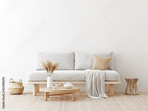 Fotografiet Living room interior wall mockup in warm neutrals with low sofa, dried Pampas grass, caned table, trendy basket and japandi style decor on empty white wall background