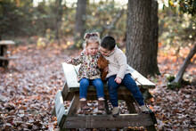 Young Children Having Fun Outdoors On A Fall Day