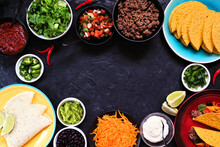 Taco Bar Frame With Assorted Ingredients. Above View On A Dark Slate Background. Mexican Food Buffet. Copy Space.