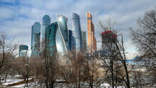 Moscow Skyscrapers In Spring Through Naked Tree Branches