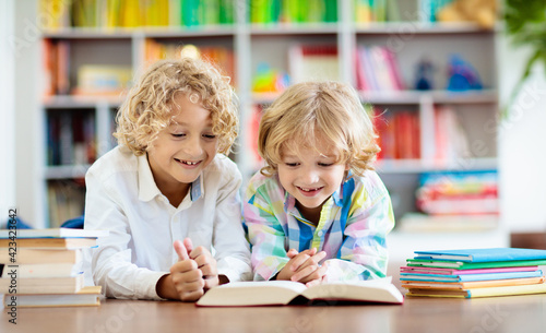 Obraz na plátně Child reading book. Kids read. School education.