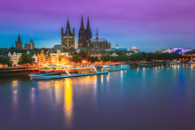 Cologne, Germany. Great St. Martin Church And Dom In Cologne At Evening With Reflection In River Rhine. Evening Blue Hour