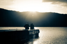 Couple At Sunset At Lake Windermere.