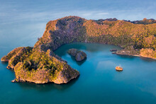 Langkawi Malaysia Aerial Ocean Cove During The Morning Golden Hours. Soft Blue Ocean Waters And Several Islands Protected By The Forested Peninsula