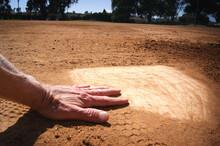 Person Sliding Into Home Plate On Baseball Feild