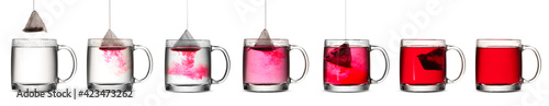 Obraz Process of making tea in glass cup on white background - fototapety do salonu