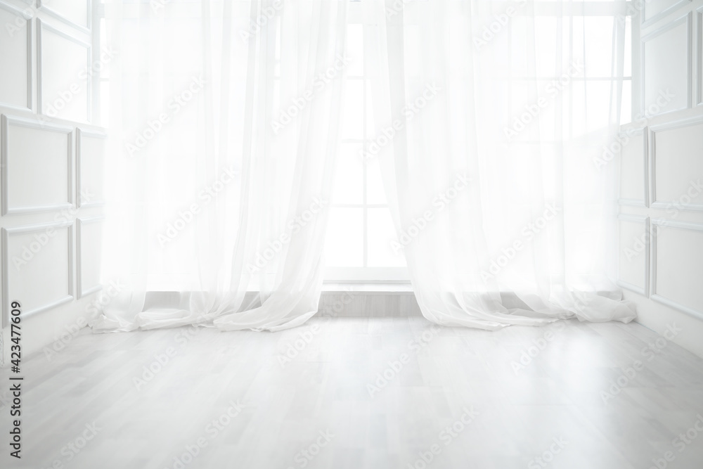 Fototapeta Backlit window with white curtains in empty room
