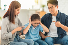 Angry Parent Scolding His Daughter In Living Room At Home