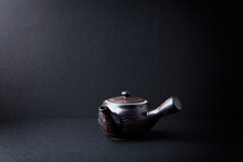 Traditional, Handcrafted Ceramic On Dark Background. Soft Focus. Copy Space.