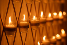 Many Burning Candles With Shallow In Church