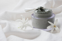 Hyacinth Flowers And Blue Clay In A Jar On A White Cloth