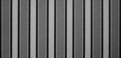 repeating gray and black lines to form a pattern