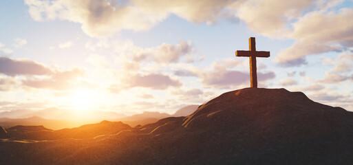Cross on mountain peak at sunset christian religion