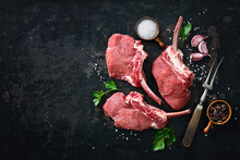 Raw Veal Frenched Racks Meat With Ingredients On Rustic Dark Background
