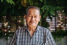 Close-up Portrait Of Smile Asian Senior Man Looking At Camera. Old Thai Man.
