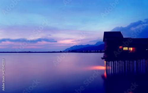boathouse shed outbuilding sky building water sunset sea clouds lake ocean lands Fototapete