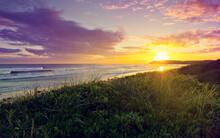 Sun Sunset Star Sky Ocean Celestial Body Landscape Water Sunrise Beach Summer Sea Clouds Dusk Coast Travel Shore Horizon Grass Reflection Lake Evening Cloud Scenic Shoreline Orange Sand Dawn Rural Env