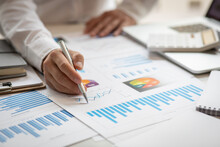 Business Man Hands Hold Documents With Financial Statistic Stock Photo,discussion And Analysis Data The Charts And Graphs. Finance Concept