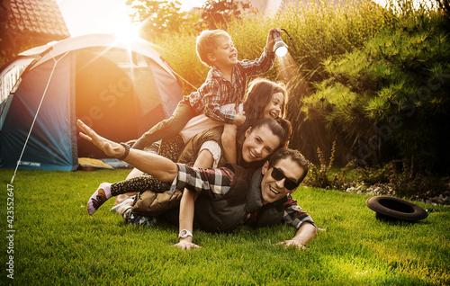 Obraz na płótnie Cheerful family realxing on a camp