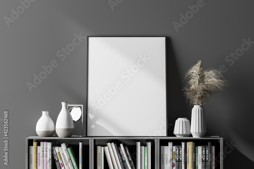 Fotografie, Obraz Dark interior with empty poster above the bookshelf