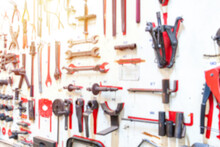 Front Of Layout Tools Of Technician On White Wooden Board. Repair Equipment And Many Handy Tools. Repair Tool Kit.