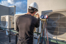 HVAC Mechanic Servicing A Mini Split AC