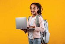 Black Girl Wearing Backpack Standing With Laptop At Studio