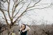 canvas print picture - Frau mit Lämmchen auf den Schultern