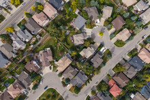 Calgary, Alberta, Canada, Aerial Top Down View Of Houses And Streets In Beautiful Residential Neighbourhood During Fall Season.