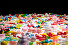Random Candy, Shallow Depth Of Field. Mixed Colorful Lollipops And Gums, Unicorn Poop Marshmallows Explosion. Variety Flavoured Confetti Of Sweets, Sugar And Cake Icing, Caramel Feast Celebration