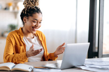 Online Communication. Confident Joyful Beautiful African American Young Female Student Or Freelancer With Afro Dreadlocks, Study Remotely, Talks By Online Conference With Coworkers Or Teacher, Smile