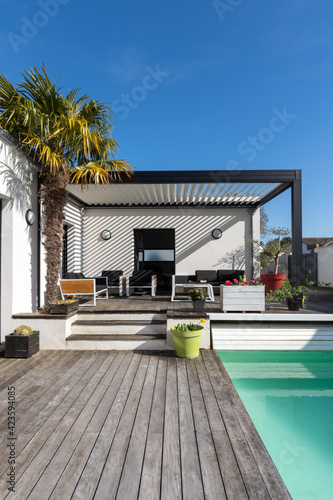Trendy outdoor patio pergola shade structure, awning and patio roof, garden loun Fototapeta