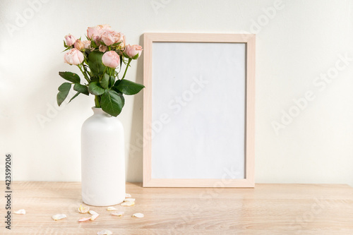 Papel de parede Portrait white picture frame mockup on wooden table
