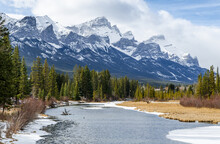Canmore, Spring Creek & Rocky Mountains. Rocky Mountains Vie From The Wooden Bridge Over The Spring Creek.