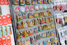 Sale Of Magnets, Postcards, Bottle Openers, Bookmarks, Calendars, Key Rings And Other Souvenirs On The Street Of Istanbul. Gift And Keepsakes From Travels By Turkey.