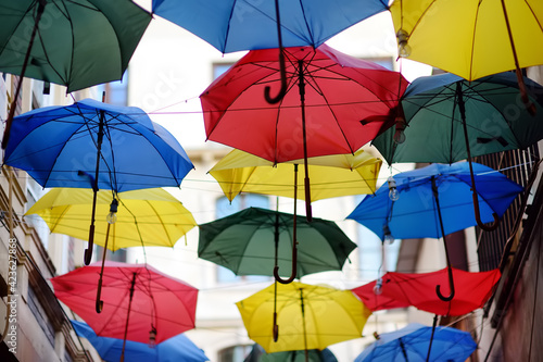 Fotografie, Obraz Colorful umbrellas hanging over narrow street of old town, Istanbul, Turkey