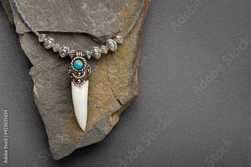 Silver pendant-amulet with crocodile fang Fototapet