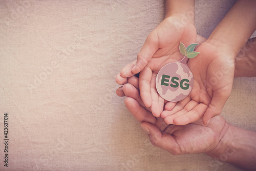 Obraz Hands holding growing tree on earth, ESG Environmental, social and corporate governance concept - fototapety do salonu