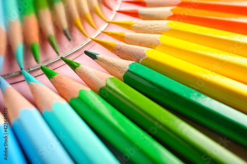 Composition with colorful pencils on color background Fototapet