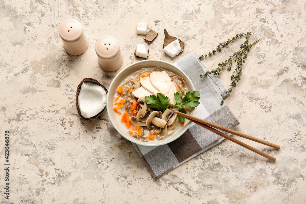 Fototapeta Bowl with Thai chicken noodle soup on grunge background