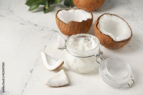 Fotografia, Obraz Jar with coconut oil on light background