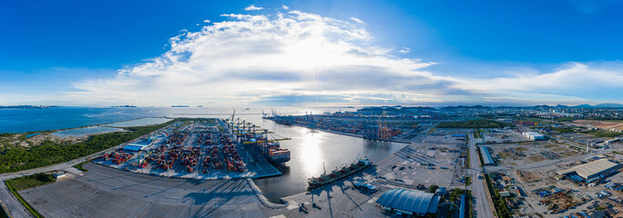 Panorama Aerial view Sunset scene of Loading big vessel in the port of laemchabang terminal, Container Crane, Unloading Containers