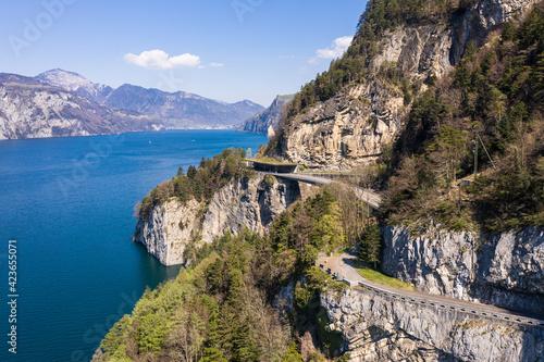Fototapeta Coastal road along lake Lucerne in Canton Schwytz in Central Switzerland on a su