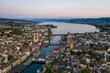 Aerial view of the twilight over Zurich old town where the Limmat river reaches lake Zurich in Switzerland largest city.