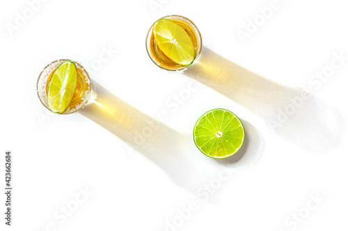 Obraz Tequila shots with salty rims and lime slices, overhead flat lay shot - fototapety do salonu